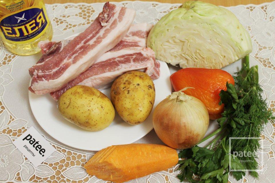 Свиные ребрышки тушенные с овощами